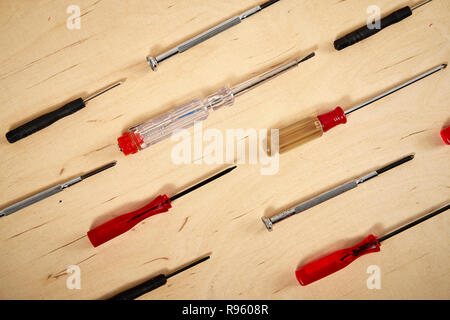 pattern background of various screwdrivers on  wooden work table - Stock Photo