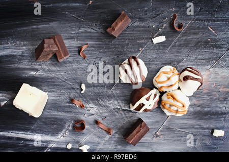 White and Dark Chocolate truffles for Christmas or Valentines's Day with chocolate bark and shavings around them. - Stock Photo