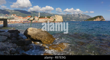 MONTENEGRO, BUDVA, 31 July 2014: View of old district of Budva and the Statue of Ballet Dancer on summer day - Stock Photo