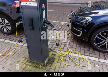 Electric car charging point in Amsterdam, Netherlands - Stock Photo