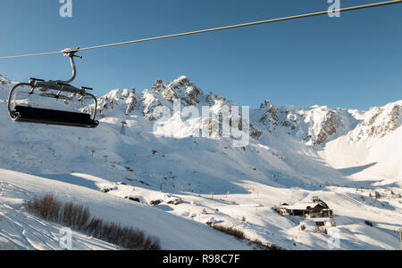 Chairlift Biollay in Courchevel 1850 looking towards La Saulire highest mountain point in Courchevel Valley ski resort 3 Valleys France French Alps - Stock Photo