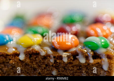 chocolate cakes or commonly known as brownies, decorated with candies, cookies and different sweet sauces - Stock Photo