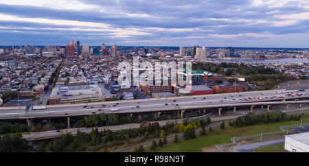 The buildings are illuminated in the downtown urban core of Baltimore Maryland - Stock Photo