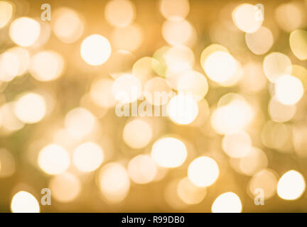 Blurred Bokeh Christmas Glowing Golden Background. Christmas Lights. Gold Holiday New Year Abstract Glitter Defocused Background With Blinking Stars and Sparks. - Stock Photo