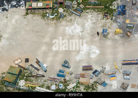 Aerial view of construction site with copy space in the middle - Stock Photo