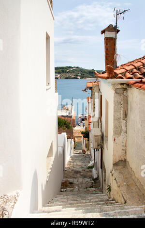 SKIATHOS, GREECE - AUGUST 18, 2017. Winding alleyways and traditional houses, Skiathos Town, Greece, August 18, 2017. - Stock Photo