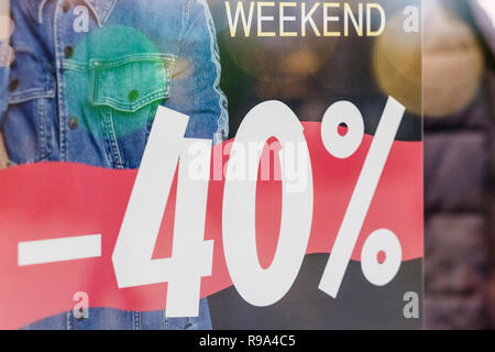 Sales promotion fashion clothes retail store in shopping mall, sale label sign sticker in front of shop door glasses. front of shop,winter shopping season.marketing business advertisement for clearance shop - Stock Photo