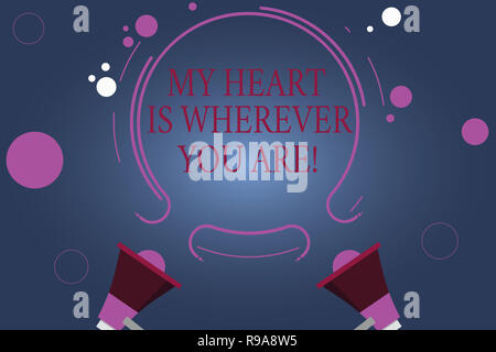 Word writing text My Heart Is Wherever You Are. Business concept for Expressing roanalysistic feelings and emotions Two Megaphone and Circular Outline - Stock Photo