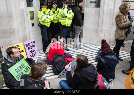 London, UK. 21st December, 2018. Environmental campaigners from Extinction Rebellion stage a sit-down protest outside BBC premises in protest against the broadcaster's lack of coverage of the climate change crisis. Credit: Mark Kerrison/Alamy Live News - Stock Photo