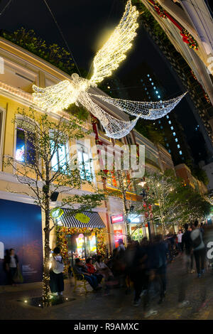 Hong Kong, China. 22nd December, 2018. Christmas and new year decorations light up at the famous Lee Tung Avenue, the new urban renewal development in Hong Kong, China. Credit: Bob Henry/Alamy Live News - Stock Photo