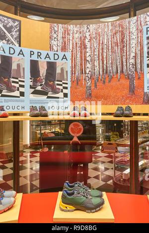 MILAN, ITALY - CIRCA NOVEMBER, 2017: a window display at Prada store in Galleria Vittorio Emanuele II. - Stock Photo