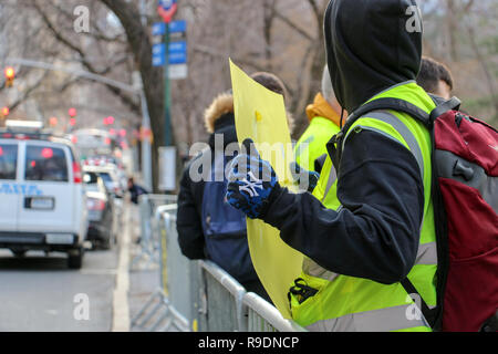 New York, New York, USA. 22nd Dec, 2018. Yellow vest NYC Protest at the French Consulate. Demonstration for solidarity for protestors in France and to come together against ruling class and it's politicians worldwide. Credit: SCOOTERCASTER/Alamy Live News - Stock Photo