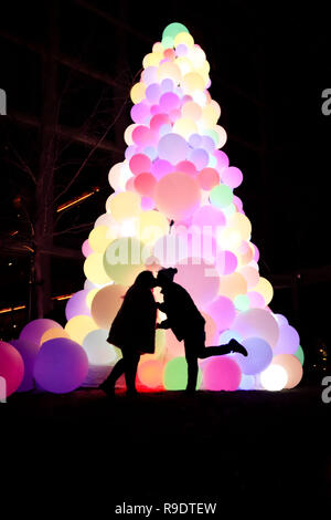 New York, New York, USA. 22nd Dec, 2018. Christmas tree made of lighted balls, with a view of Manhattan Island. Credit: William Volcov/ZUMA Wire/Alamy Live News - Stock Photo