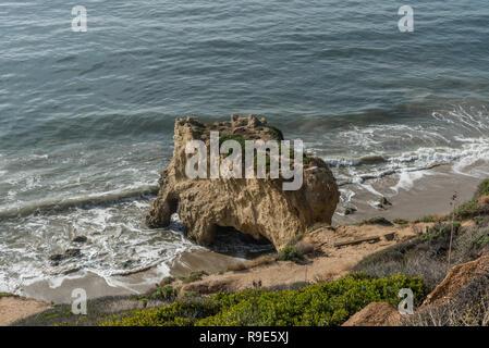 Interesting animal head shaped natural rock formation at the El Matador State Beach in Malibu, California - Stock Photo