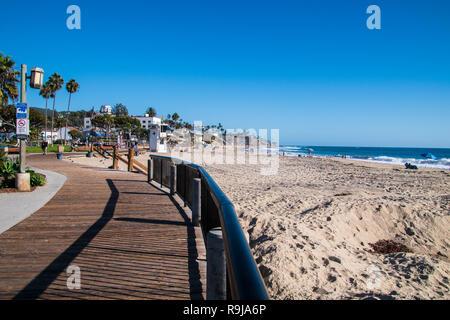 Laguna Beach, California - October 9, 2018: Boardwalk and beach with tourists at Laguna Beach California as seen on this date. - Stock Photo