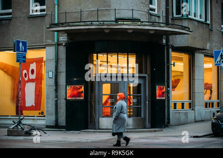 Helsinki, Finland - December 7, 2016: Woman walking near Entrance To Galleria Sinne. Sinne is a venue for Finnish and international contemporary art. - Stock Photo