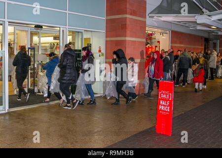 Southport, Merseyside, UK 26th December 2018. 6am Start for Sales at Next as queues form for high street discounts and post Christmas bargains.  People queuing at some stores were issued with large clear plastic bags to contain their purchases, and make their 'half price' sale items visible to in store supervisors. Shoppers will always expect a manic experience trying to get to the Next Boxing Day sale in stores. Credit: MediaWorldImages/AlamyLiveNews. - Stock Photo