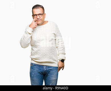 Middle age arab man wearing glasses over isolated background Pointing to the eye watching you gesture, suspicious expression - Stock Photo