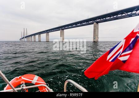 Oresundsbron. The Oresund bridge link between Denmark and Sweden, Europe, Baltic Sea. View from sailboat yacht under uk british ensign. Traveling. - Stock Photo