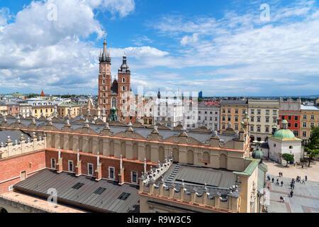 View from the Town Hall Tower (Wieża ratuszowa) over Cloth Hall (Sukiennice) towards St Mary's Basilica, Main Square (Rynek Główny), Kraków, Poland - Stock Photo