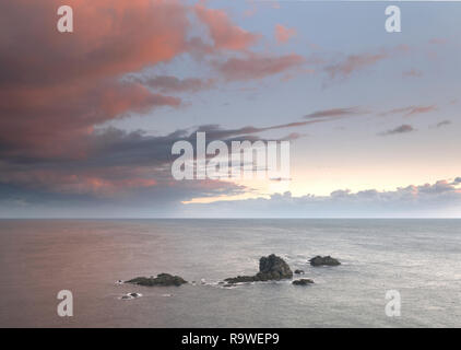 Clouds gathering over Lizard Point at sunset - Stock Photo