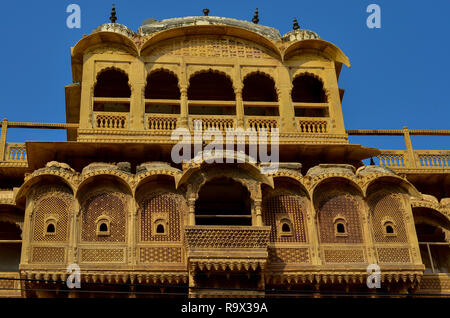 Traditional Rajasthani haveli with a decorated window at Patwon ki haveli in Jaisalmer, Rajasthan, India. - Stock Photo