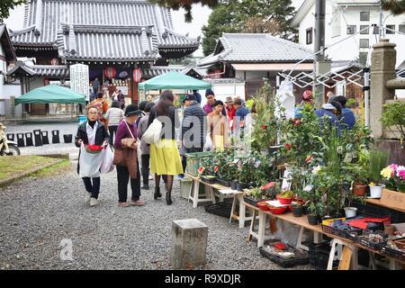 KYOTO, JAPAN - NOVEMBER 25, 2016: People visit Kitano Tenmangu shrine flea market in Kyoto, Japan. The monthly flea market takes place on 25th day of  - Stock Photo