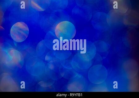Abstract blurry blue background with colorful circles floating in the night - Stock Photo