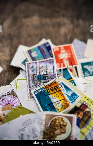 Selection of used postage stamps from around the world - Stock Photo