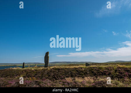 The Ring of Brodgar, a Neolithic monument and part of the Orkney Neolithic World Heritage Site in the Orkney Islands of Scotland - Stock Photo