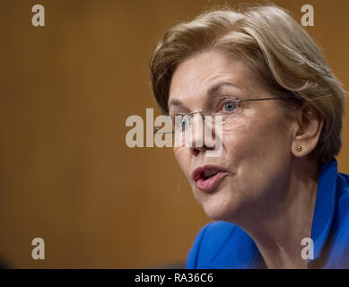 January 23, 2018 - Washington, District of Columbia, United States of America - United States Senator Elizabeth Warren (Democrat of Massachusetts) asks questions during testimony before the US Senate Committee on Banking, Housing, and Urban Affairs during the confirmation hearing for Jelena McWilliams, to be Chairperson and a Member of the Board of Directors of the Federal Deposit Insurance Corporation; Dr. Marvin Goodfriend, to be a Member of the Board of Governors of the Federal Reserve System; and Mr. Thomas E. Workman, to be a Member of the Financial Stability Oversight Council, on Capitol - Stock Photo