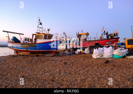 Hastings East Sussex, UK. 1st Jan, 2019. Lone fisherman sorts his nets at dawn on New Year's Day. Hastings with 25 working boats has one of the largest beach launched fishing boat fleets in Europe. - Stock Photo