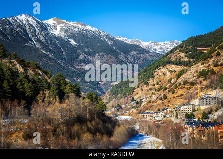 A nice landscape in Andorra with a snow cape mountain in the background - Stock Photo