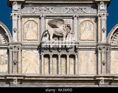 Venetian lion on facade, Scuola Grande di San Marco, Venice, Veneto, Italy - Stock Photo
