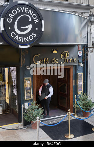 Doorman at the entrance to the Cafe de Paris, a West End nightclub, on Coventry Street, London, England. - Stock Photo