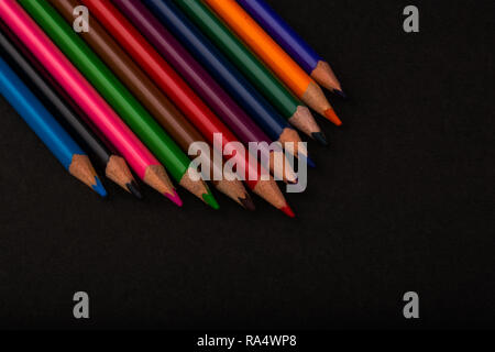 Color Pencils On Black Background - Stock Photo