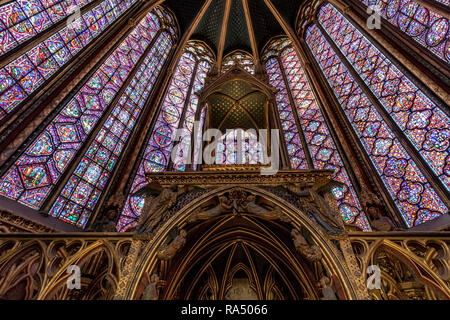 The Altar in and stained glass windows of  Sainte-Chapelle s a royal chapel in the Gothic style, within the medieval Palais de la Cité , Paris - Stock Photo