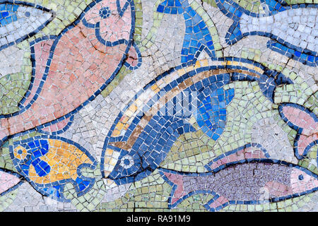 Fish mosaic decoration made of tale. Old, vintage abstract colorful background from small ceramic tiles square lead. Venetian mosaic - Stock Photo