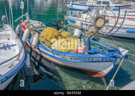 GREECE - CORFU - KOULOURA - JULY 25, 2018: Fishing boat in the port of Kouloura in Corfu, Greece. - Stock Photo
