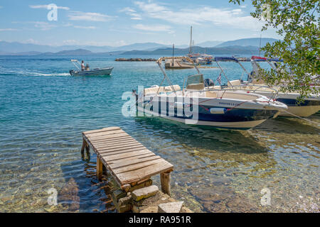 GREECE - CORFU - KOULOURA - JULY 29, 2018: Moored boats in the harbor of Kouloura in Corfu, Greece. - Stock Photo