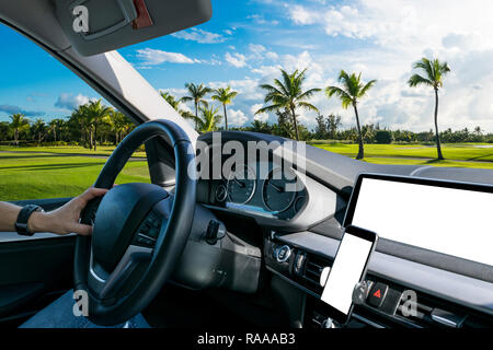 Male hands holding car steering wheel. Hands on steering wheel of a car driving. Driving a car inside cabin. Multimedia system and smartphone isolated - Stock Photo