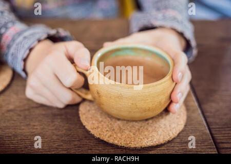Homemade Indian Sweet masala tea. Spices - cardamom, cinnamon, ginger - Stock Photo