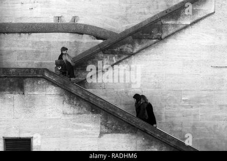 London/England - March 07 2015: People walking up an aging flight of stairs by Waterloo Bridge Southbank London - Stock Photo