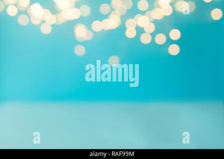 Blue background against defocused light. Holiday celebration concept. Copy space - Stock Photo