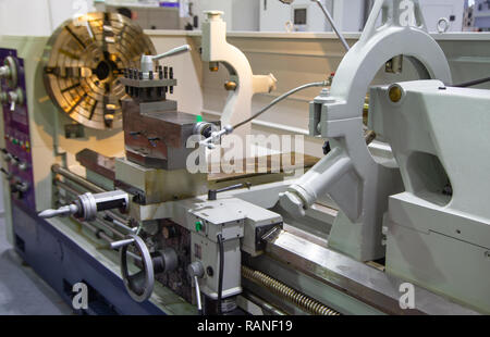 Close-up of manual lathe machine, industrial metalwork manufacturing - Stock Photo