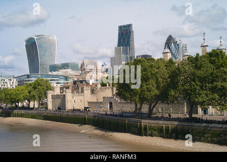 London, UK - May 24, 2016: The Tower of London with the City of London in the Background and the River Thames in the Foreground. Among the modern buil - Stock Photo