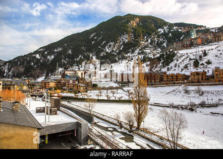 Hotels in the bottom of a mountain with snow during the winter of Andorra in Europe - Stock Photo