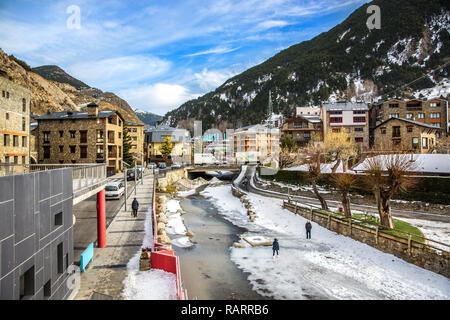 Andorra, Andorra - Dec 4th 2018 - Tourists having fun in front of hotels in the bottom of a mountain with snow during the winter of Andorra in Europe - Stock Photo