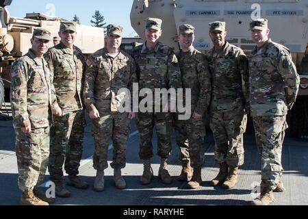 From left to right: Command Sgt. Major Jerry Morales and Lt. Col. Frank Buchheit, of 1-94 Field Artillery Regiment,  Sgt. 1st Class Zachery Wilkerson, A Battery, 1-94 FAR, 17th Field Artillery Brigade,  Lt. Gen Stephen R. Lanza, I Corps,  Cpt. Jamie Holm, A Battery, 1-94 FAR, 17th FA Brigade, Col. Andrew Gainey and Command Sgt. Major Joe Winstead, 17th FA Brigade, pose for a photo on Joint Base Lewis-McChord, Wash., Feb. 13, 2016. Wilkerson was recognized for winning the U.S. Army Field Artillery's Gruber Award. Established in 2002, the Gruber Award is presented to an individual artillery Sold - Stock Photo