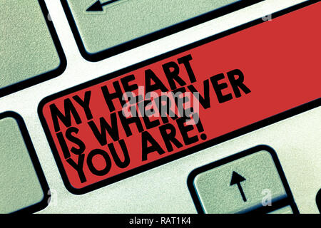 Word writing text My Heart Is Wherever You Are. Business concept for Expressing roanalysistic feelings and emotions Keyboard key Intention to create c - Stock Photo